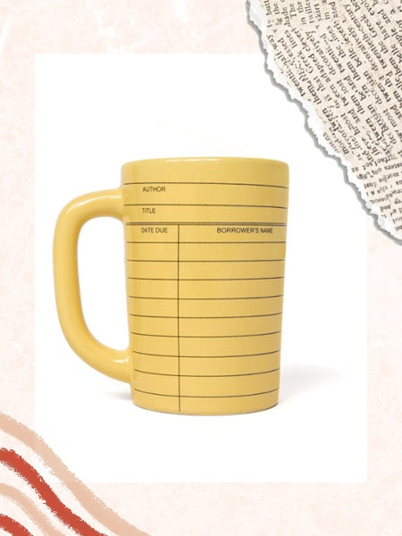 A cozy drink is the perfect partner to a good book. Here is the Out of Print mug on scrapbook background, perfect for those cozy drinks.