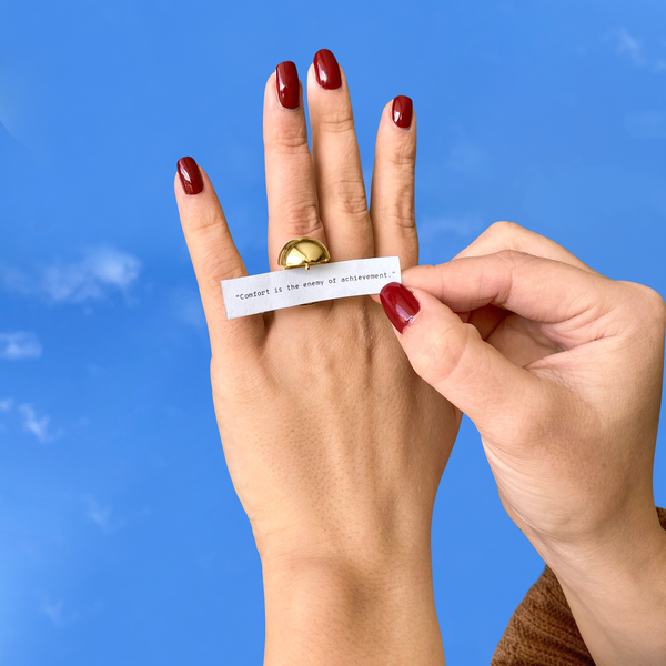 Shown here: Our Sphere Secret Ring holding a fortune for the fire sign.