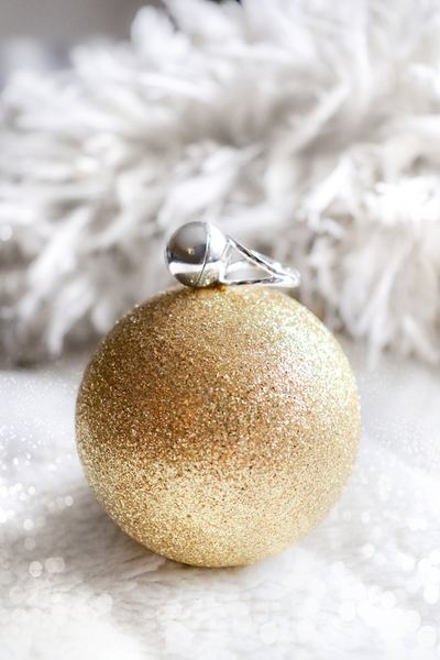Shown here: Our Sphere Secret Ring, a thoughtful Christmas gift for mom.