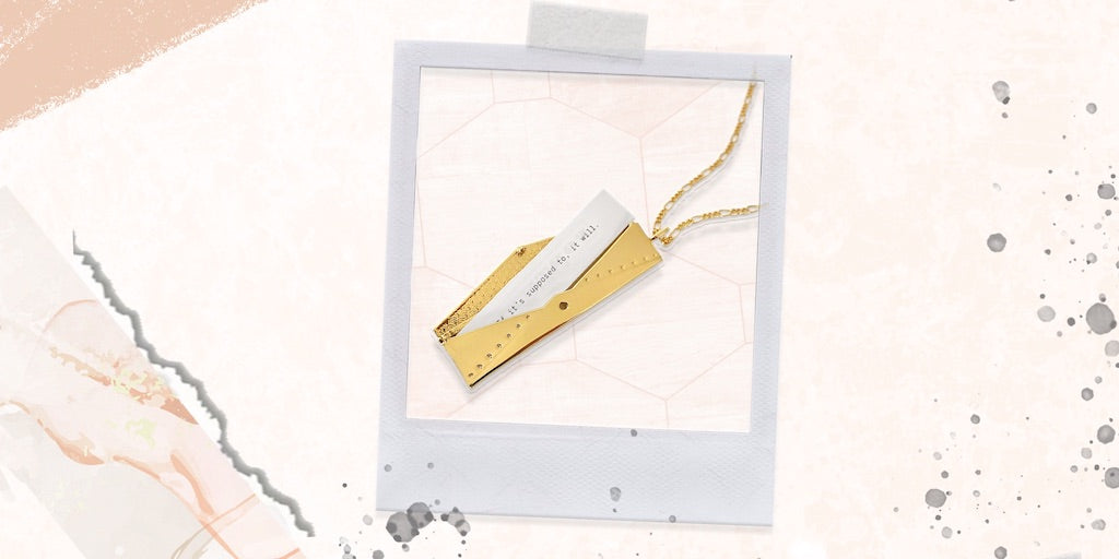 A gold Envelope Locket that holds a personalized message inside - a meaningful gift sisters.