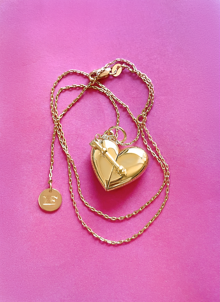 Shown here: Our Heart + Arrow Locket, a thoughtful Valentine's Day gift idea for her.