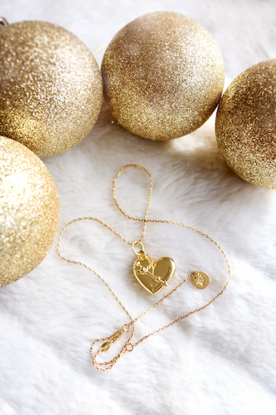 Shown here: Our Heart + Arrow Locket, a thoughtful Christmas gift to add a message inside