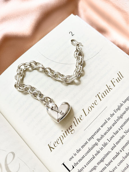 Shown here: A Heart + Arrow Bracelet for someone who has a quality time love langauge.