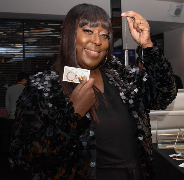 Loni Love with her Fortune & Frame fortune locket at the Grammys