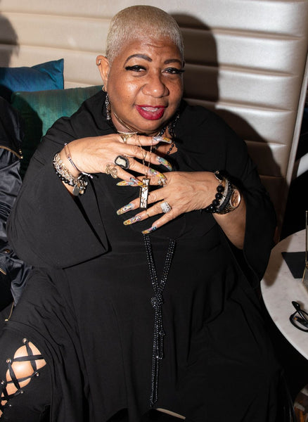 Luenell in a Flowered Vines fortune locket by Fortune & Frame