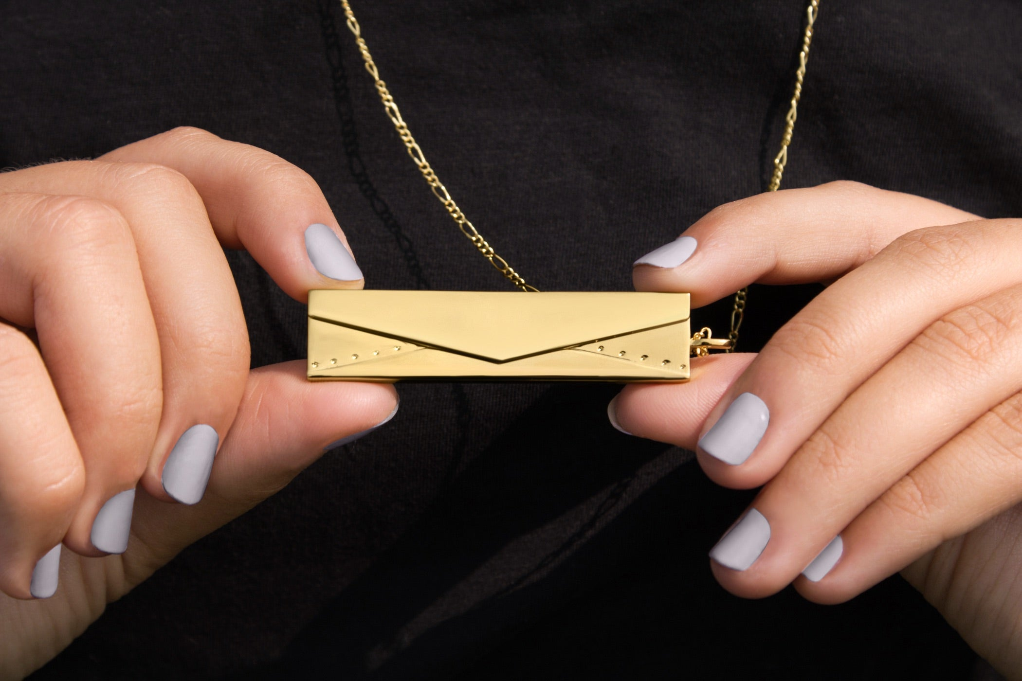 Shown here: Our Envelope Fortune Locket, a meaningful personalized anniversary gift