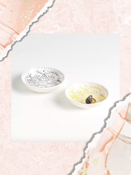 These white ceramic ring dishes with a grey and yellow paisley print are great for organizing and storing your most-worn rings.