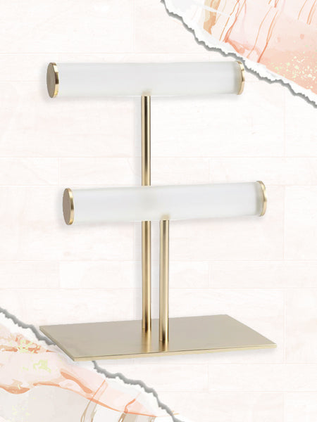 A photo of a double bar jewelry stand that's helpful for organizing and storing bracelets.