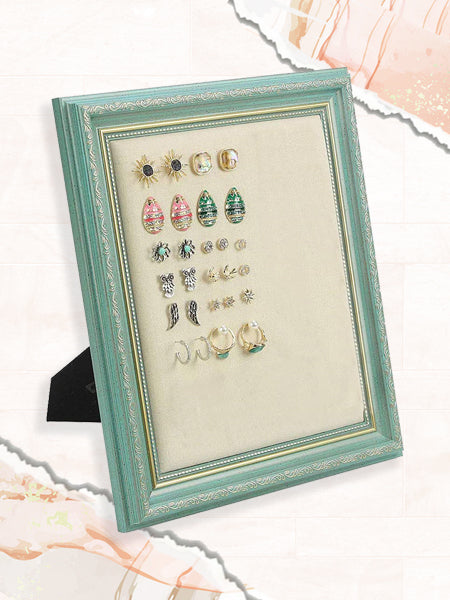 As for earring storage ideas, this plywood and linen frame makes for a great organizational option.