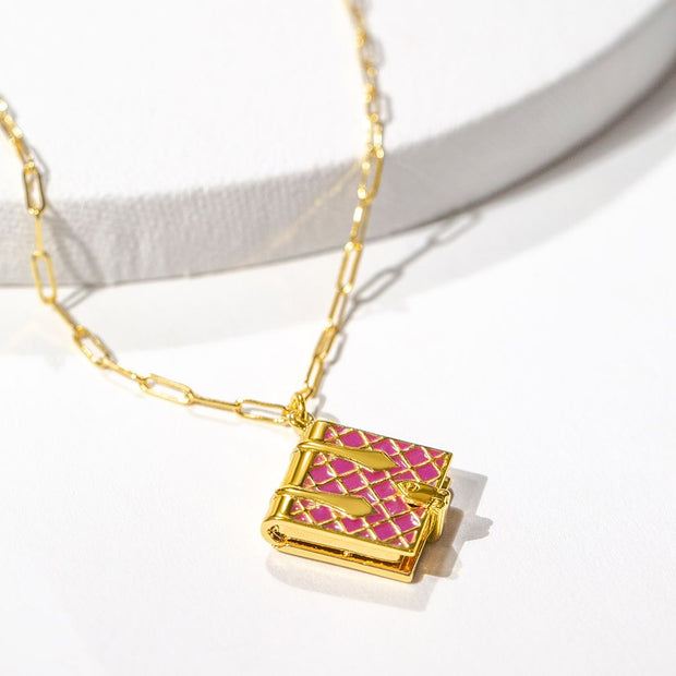 Shown here: a magenta book locket on a white background.