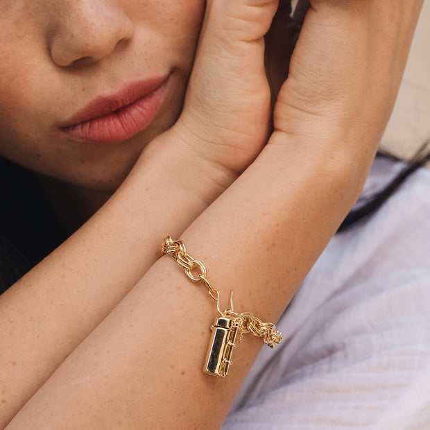 Shown here is a model wearing the capsule wand bracelet.