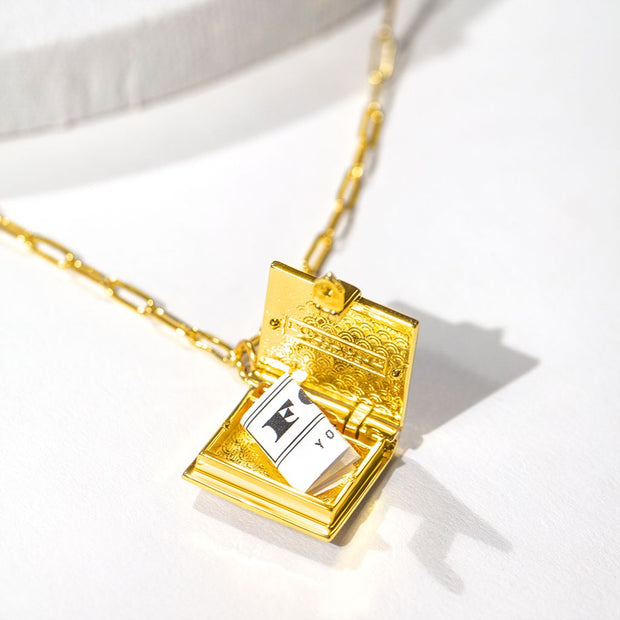 Shown here is a folded fortune in an open book locket.