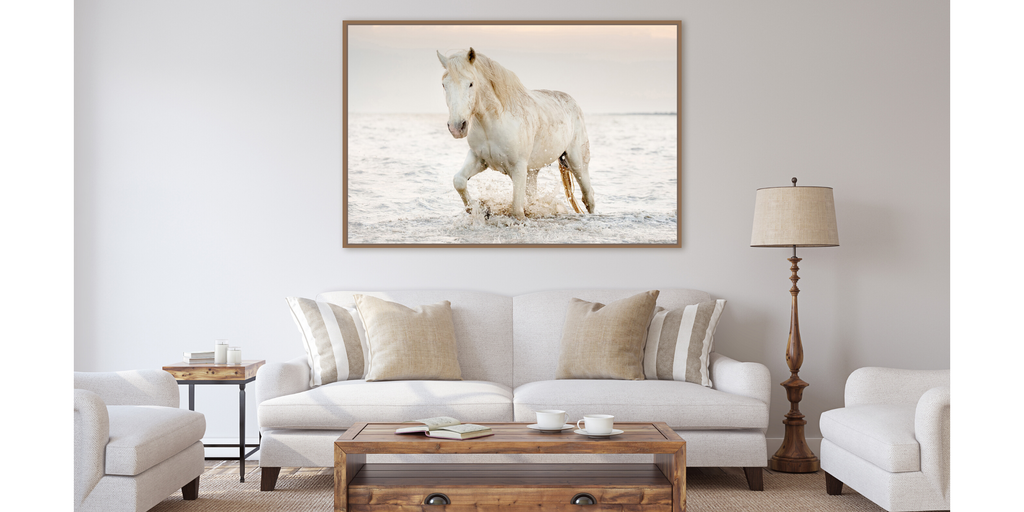 Photograph artwork of a white horse in the ocean walking through water. Camargue, France.