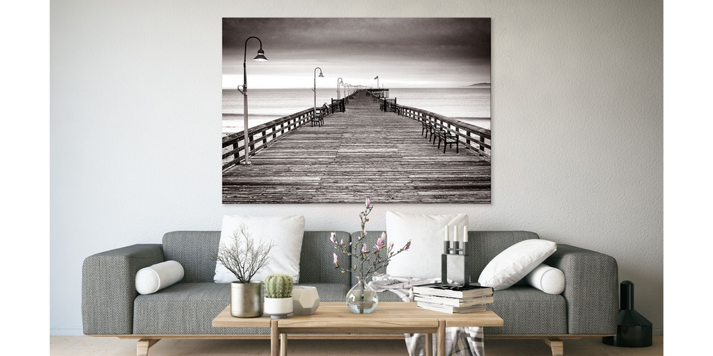 Photograph artwork of the old wooden Ventura pier. Black and white, sepia photography.