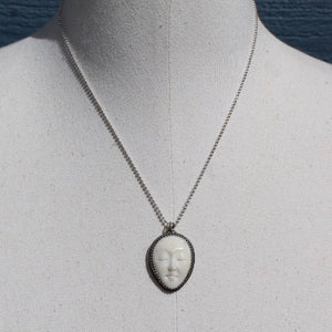 Carved Moon Face & Sterling Silver Necklace