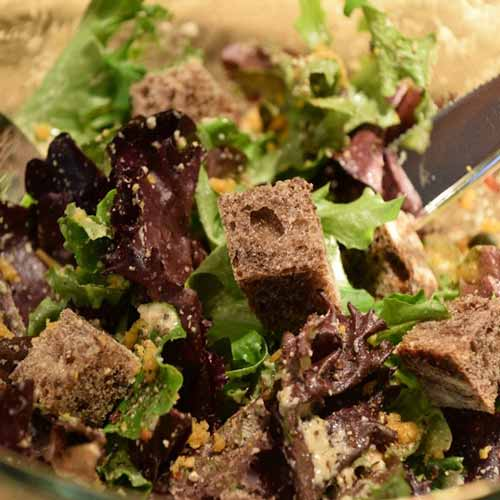 Vegan Oil Free Caesar Salad with Mixed Baby Greens and Vegan Parmesan Cheese