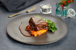 Beef feather blade served on a bed of truffled pumpkin mas, cavolo nero to the side and a red wine jus poured over the top.