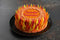 A rich chocolate cake decorated with white chocolate buttercream swirls and red, yellow and orange coloured chocolate shards to create a flame effect. Remember, remember is piped on top in red coloured chocolate.