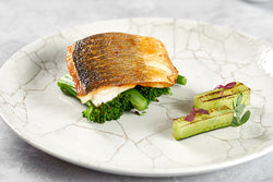 Bream with lobster glace sauvignon blanc served with scorched cucumber and wilted tenderstem broccoli