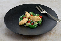 A chicken salad dish suitable for IDDSI level 4. A colourful dish made up of a salad puree, tomato gel, avocado puree, balsamic gel and finished with a spoonful of smooth and creamy chicken.