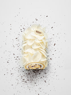 A vanilla roulade decorated with vanilla chocolate petals