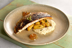 Pan fried sea bass with a herb gnocchi