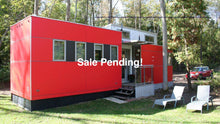 Load image into Gallery viewer, Trailer on Site 45 The Iconic Mini Home