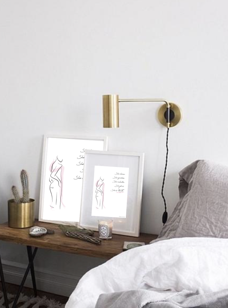 She is me radiance graphic female line print in frame on bedside table