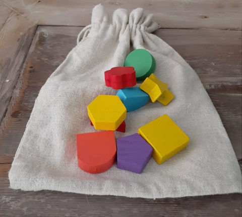 Montessori Mystery Bag with wooden shapes for abstract thinking
