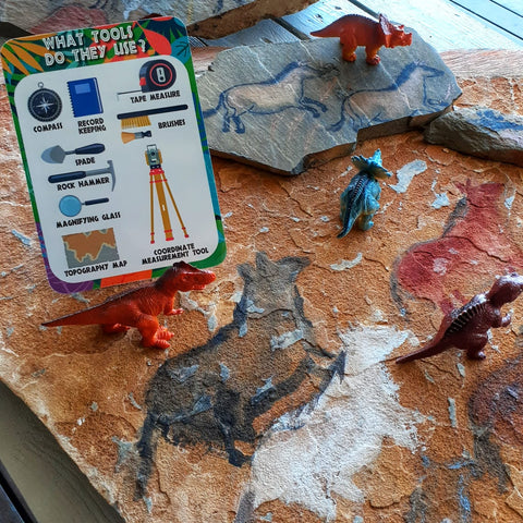 dinosaurs and rock painting