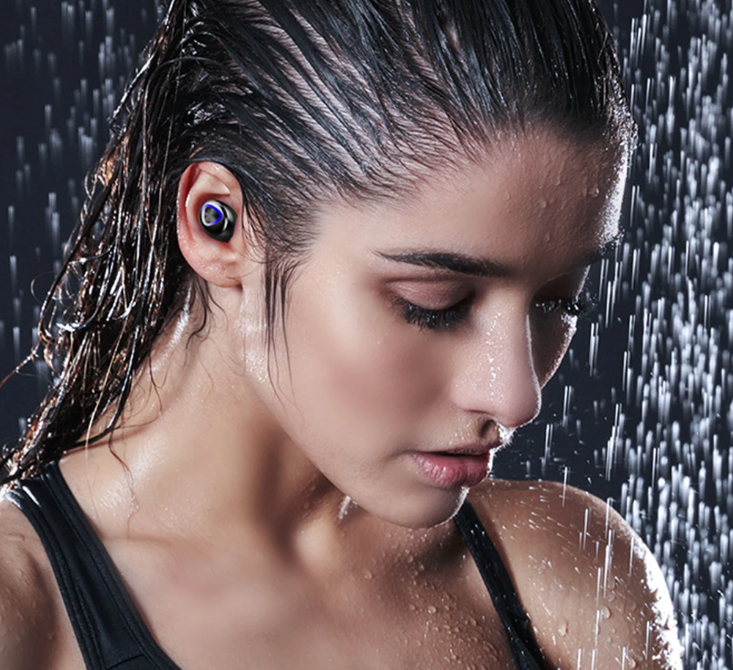 Lady showering wearing the FitM™ TWS True Wireless Waterproof Workout Bluetooth Noise Cancelling Earbuds