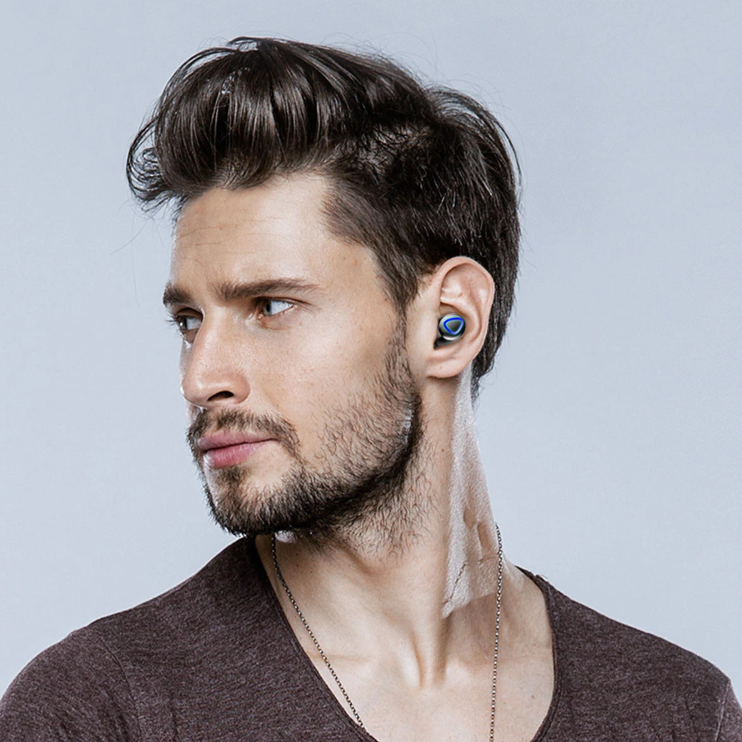 A handsome man wearing FitM™ TWS True Wireless Waterproof Workout Bluetooth Noise Cancelling Earbuds