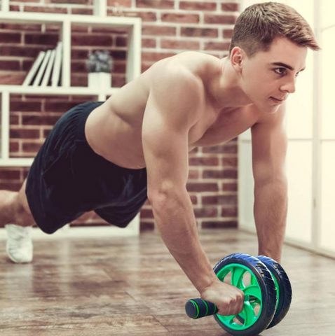A young man performing abs exercises with the 6PAC™ Ab Roller Wheel for Top Abs & Core Workout Exercises at Home