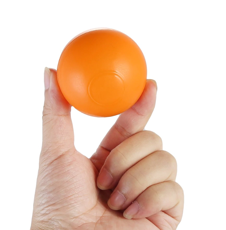 FitC™ 100pc Plastic Ball Pit Balls Pack for Baby/Kids Ball Pool single orange ball held in hand to show its size, which is 4 cm diameter.