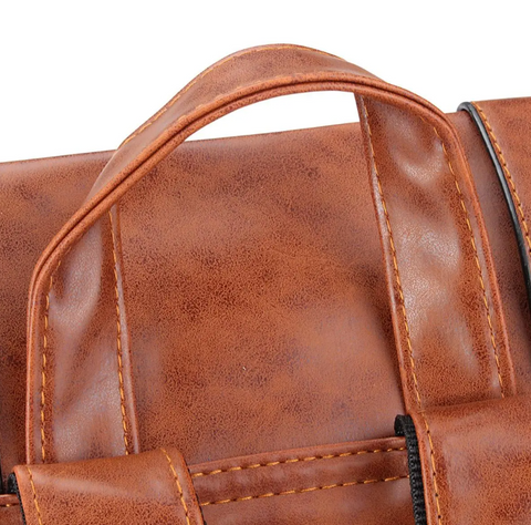 The HoldMe™ Brown Leather Women Backpack - Office/School/Travel Bookbag's top handle.
