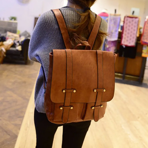 HoldMe™ Brown Leather Women Backpack - Office/School/Travel Bookbag on a women's back