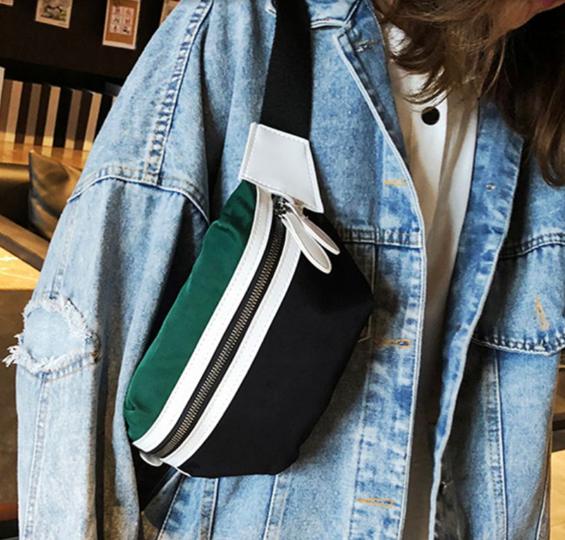 SyWear™ Women Small Canvas Waist Crossbody Phone Black & Green Bag displayed on a jeans jacket worn on the front side
