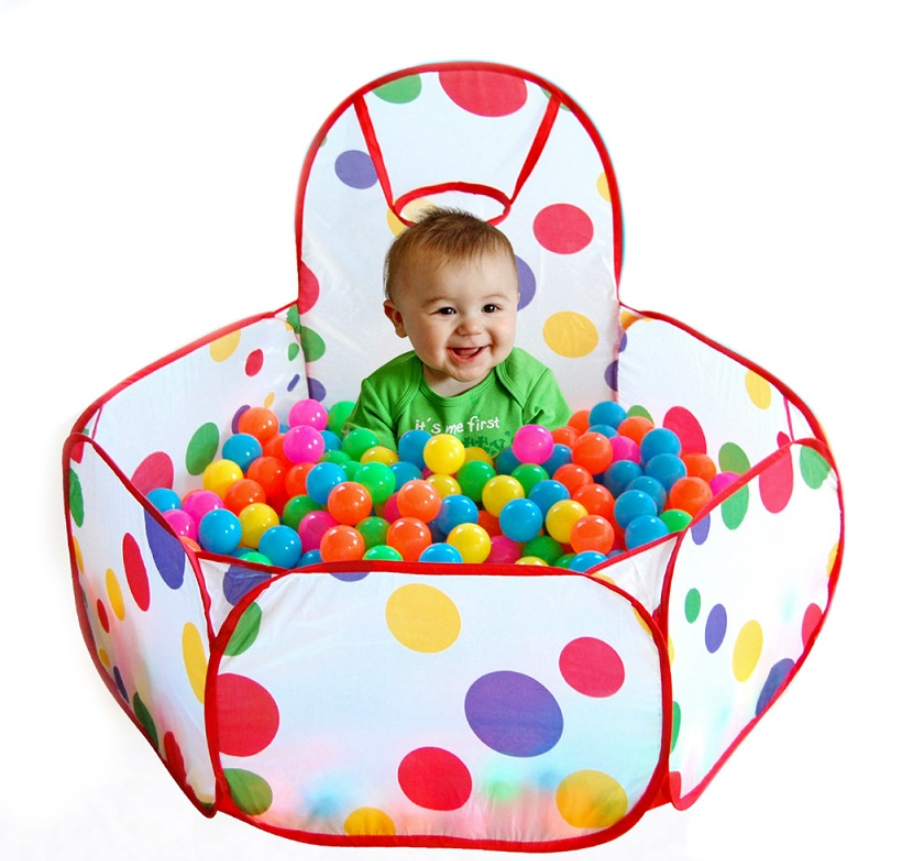 Baby enjoying playing in the FitC™ Foldable Indoor/Outdoor Baby Ball Pit Playpen for Kids w/t Ball Hop