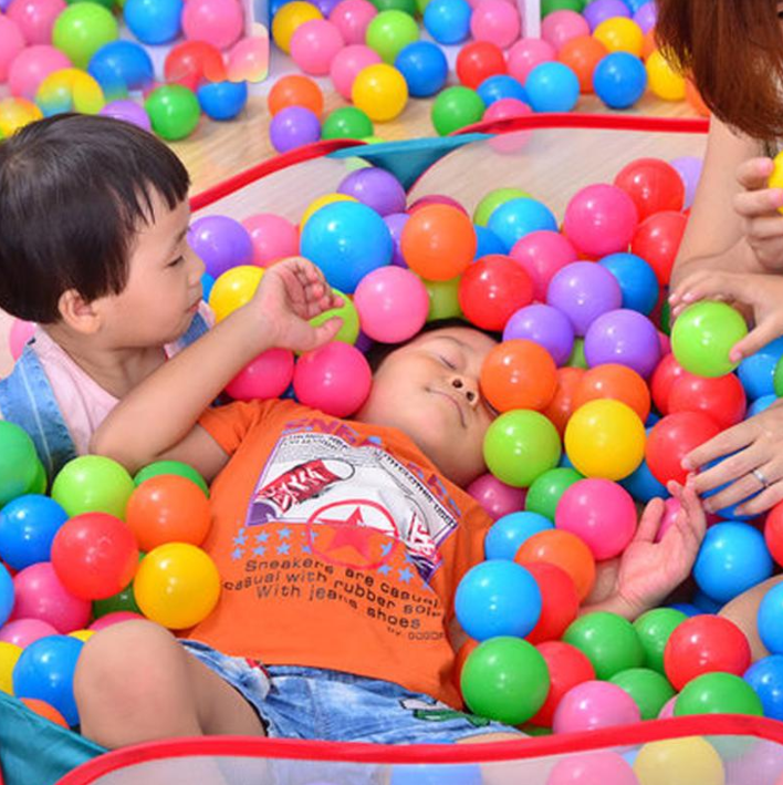 Toddlers playing in the FitC™ Foldable Indoor/Outdoor Baby Ball Pit Playpen for Kids w/t Ball Hop.