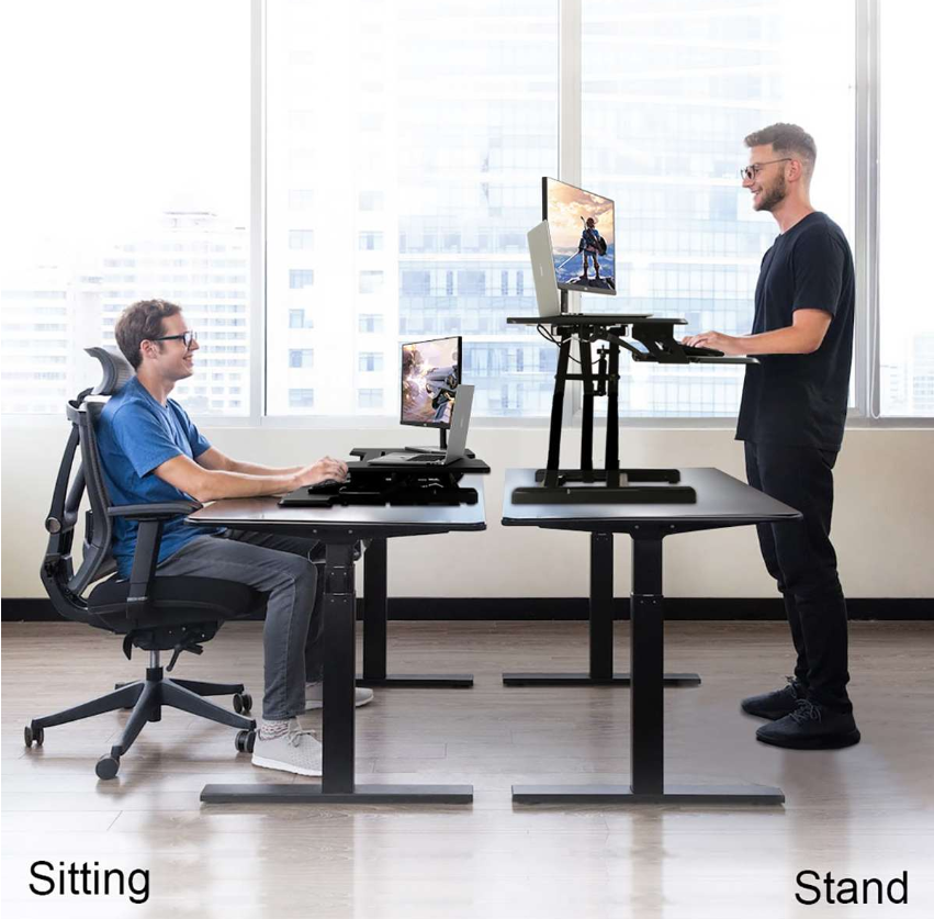 HoldMe™ Adjustable Computer Desk Riser Stand Sit Laptop Standing Table used standing (on the right side) and sitting (on the left side)