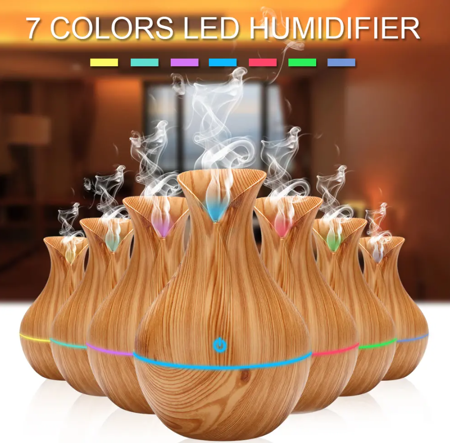 CodeLight™ Air Purifier Aromatherapy Essential Oil Diffuser Humidifier ligt-wood version displayed in all 7 colors of LED light.