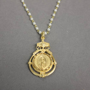 24-inch pearl chain w virgin mary in ornate setting.