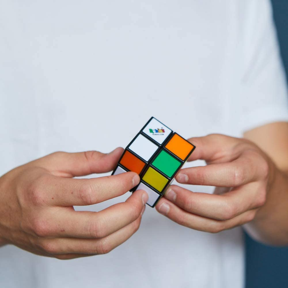kid solving rubiks mini