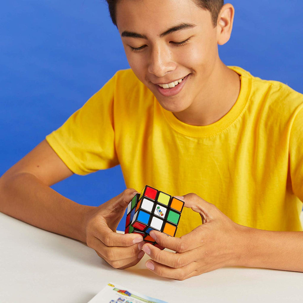 boy solving rubiks 3x3 in hong kong