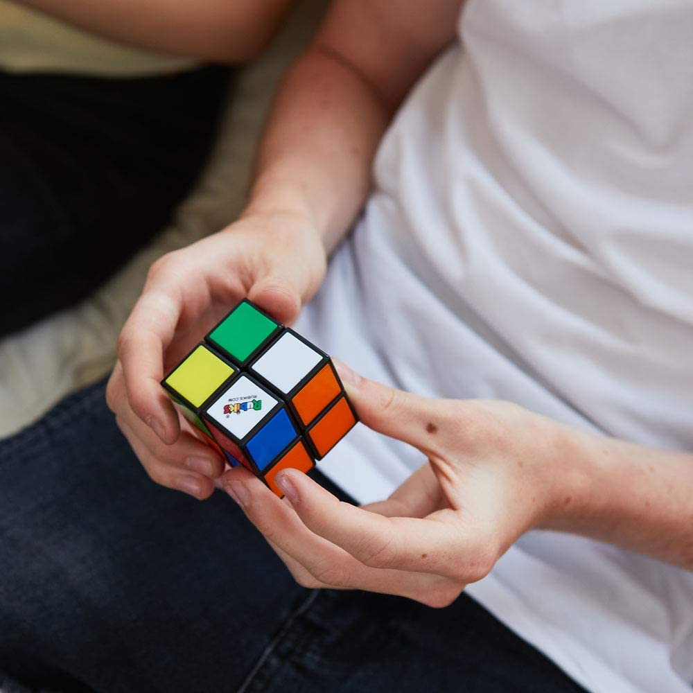 Guy solving a Rubik's 2x2 Mini