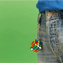 rubiks keychain attached to jeans