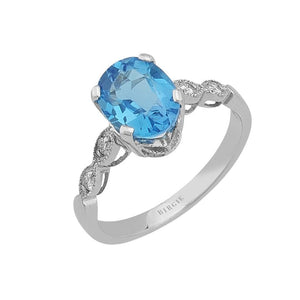 Diamond and Oval Blue Topaz Stone Ring