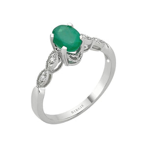 Oval Emerald and Single Prong Set Diamond Side Stones Ring
