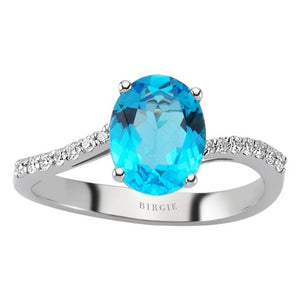 Diamond and Oval Cut Blue Topaz Ring