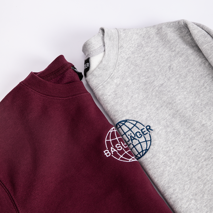 EMBROIDERED GLOBE SWEAT